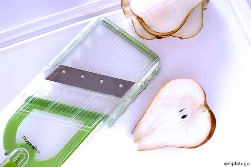 progressive mandolin pear sliced white cutting board