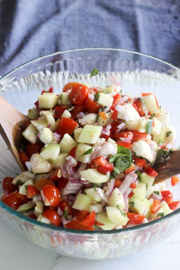combining ingredients for the best caprese salad recipe
