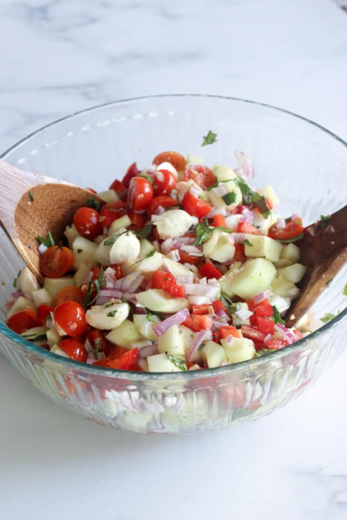 bowl of the best caprese salad with mozzarella balls