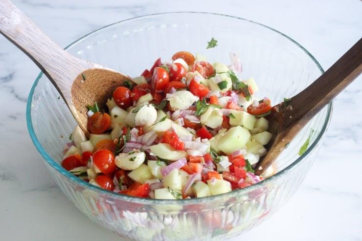best caprese salad recipe with mozzarella balls ready to serve in a bowl