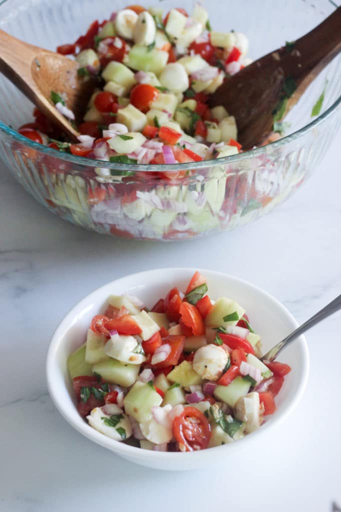 the best caprese cucumber salad in a small bowl