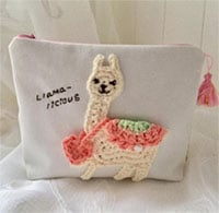 Llama makeup bag embroidered by Etsy shop mipo