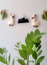 Cactus and llama nursery garland with felt llamas for a baby's room or to use as nursery bunting by Etsy shop SweeToysBaby