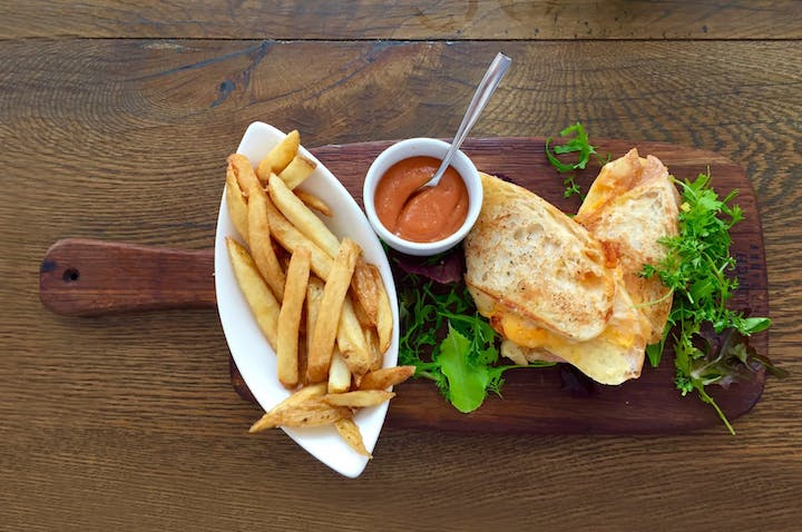 grilled cheese with a side of fries and tomato soup