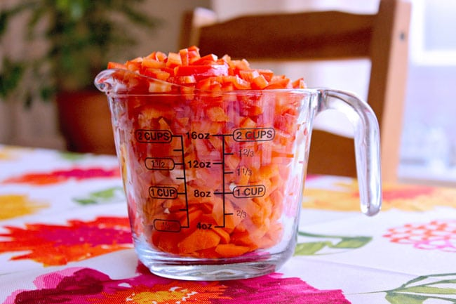 Diced red peppers and carrots for make ahead Mexican salad with ranch dressing for a BBQ or potluck
