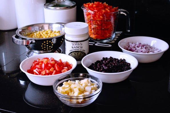 small bowls of ingredients for Mexican corn salad