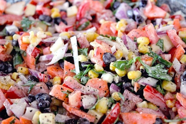 Close up of corn, black beans, peppers and other Mexican salad ingredients