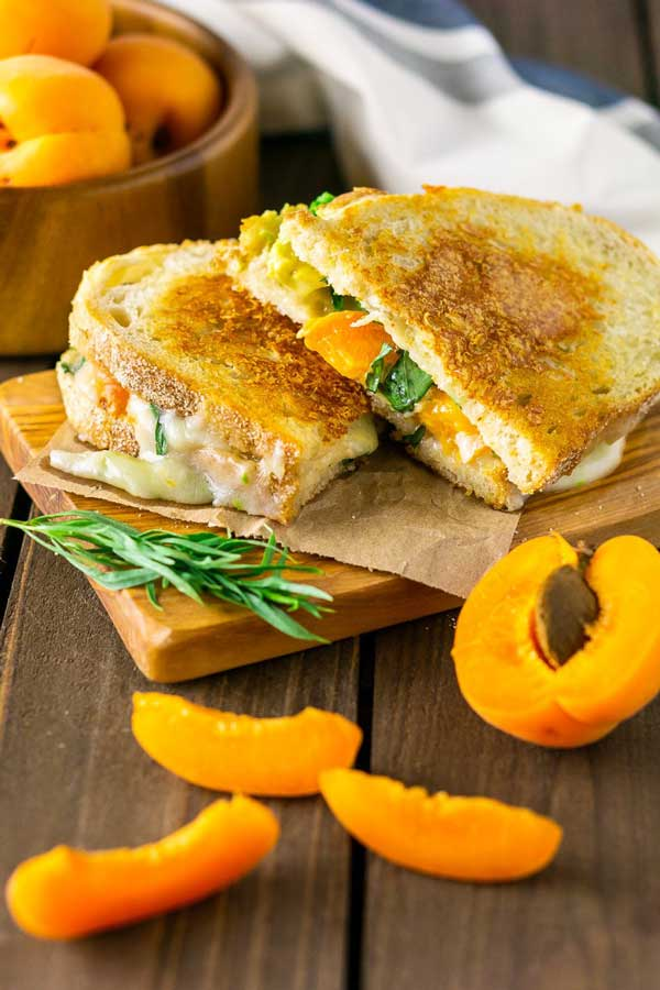 brie grilled cheese with apricot on a wood table