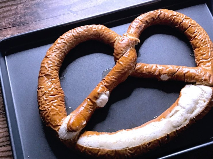 large soft pretzel on a baking sheet