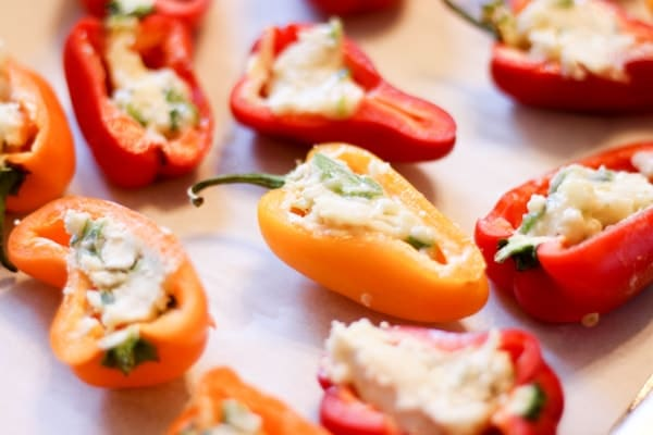 stuffed sweet peppers on a tray to bake in the oven