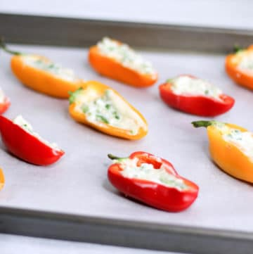 party tray of bacon and goat cheese stuffed mini peppers