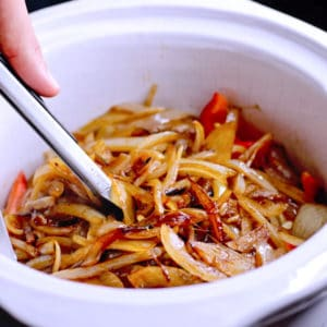 slow cooking onions and peppers in a crock pot