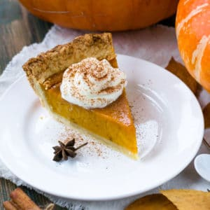 fall table with pumpkin pie slice