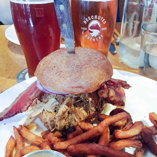 Deschutes craft beer and a pulled pork sandwich with sweet potato fries from the lunch menu