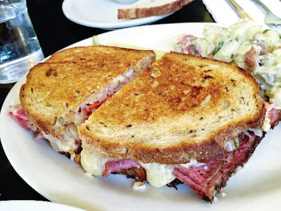 Lunch in Portland restaurant Kenny and Zukes with a pastrami sandwich