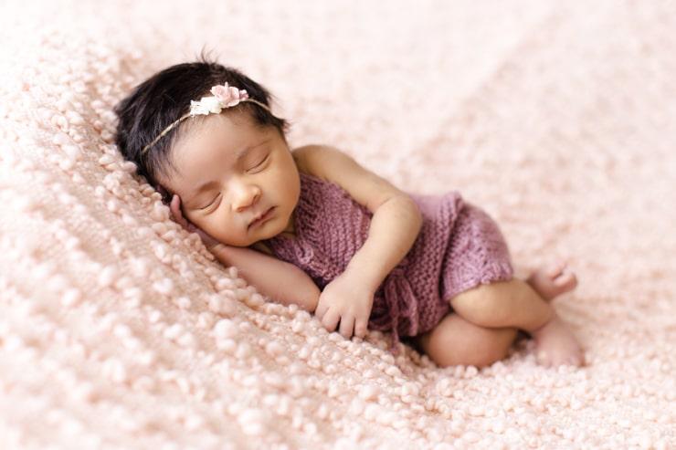 Baby sleeping in a sleeveless onesie