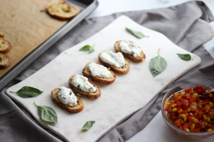 assembling whipped ricotta toasts