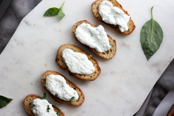 fresh whipped ricotta on top of garlic baguettes