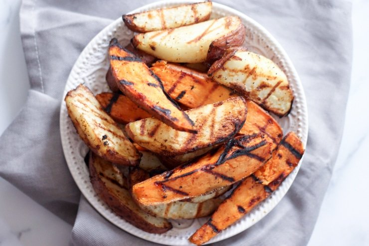 freshly grilled potatoes on a white plate