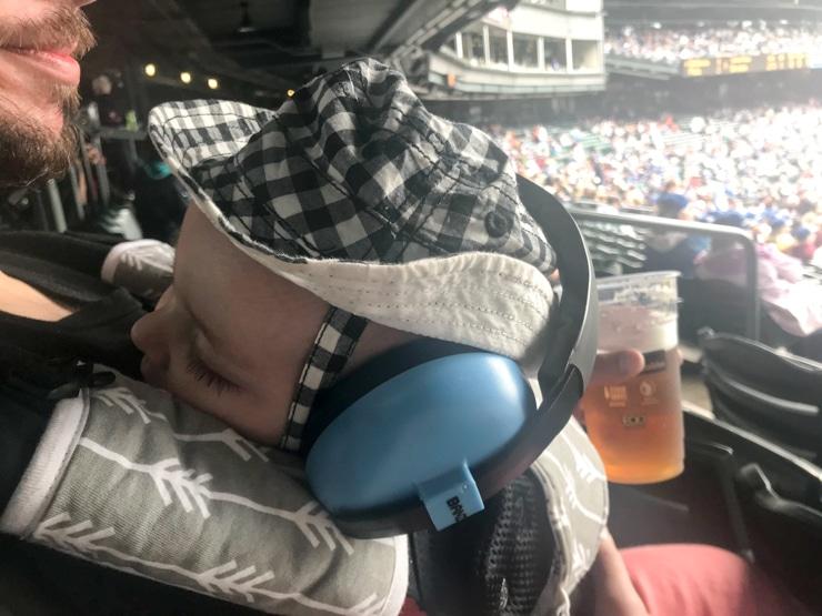 baby at baseball game