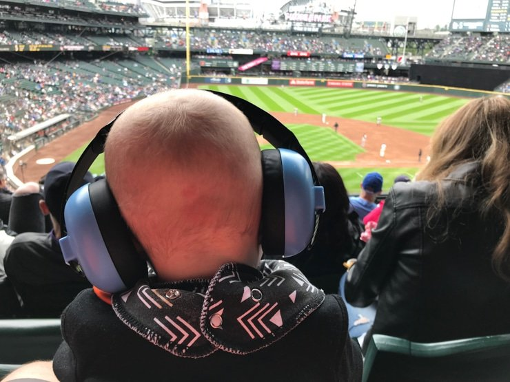 baby noise proof canceling ear muffs at a baseball game
