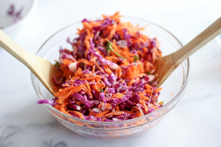 glass bowl for a crowd holding raw red cabbage slaw