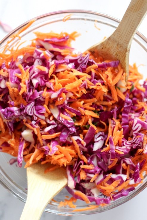 closeup of shredded red cabbage and carrot slaw with no mayo