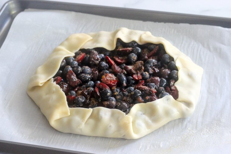 easy mixed berry galette on a baking sheet