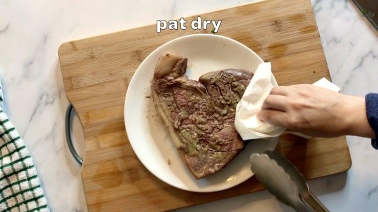 patting steak dry