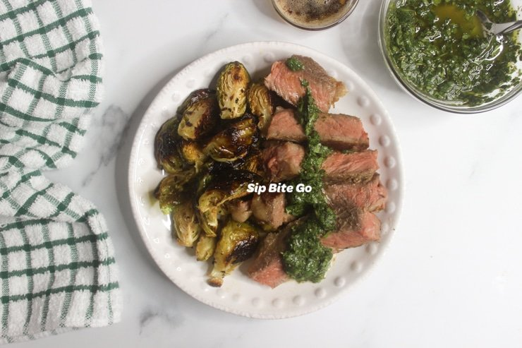 sous vide steak on a plate with green sauce