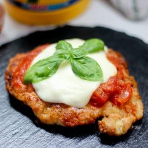 crispy Italian chicken breast with fresh basil