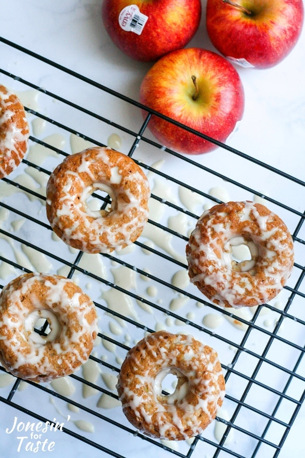 apple doughnuts on a cooling rack