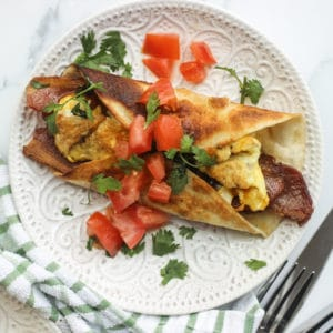 toppings on egg bacon and cheese breakfast tacos