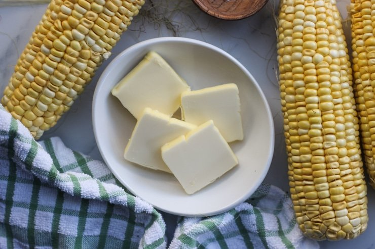 fresh corn and butter in a dish