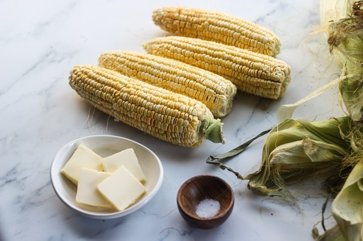 ingredients including fresh corn on the cob, butter, salt