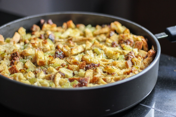 sausage, celery, onion and bread mixed together in skillet