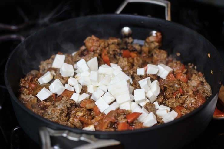mozzarella cheese and ground beef in a pan