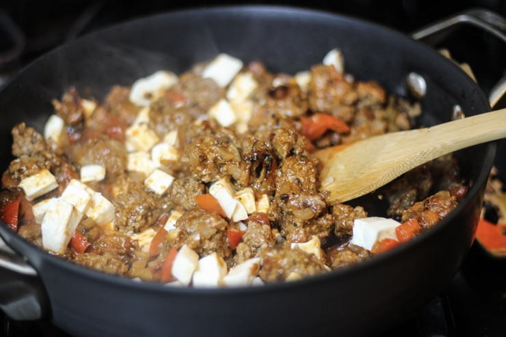 mixing together mozzarella and ground beef