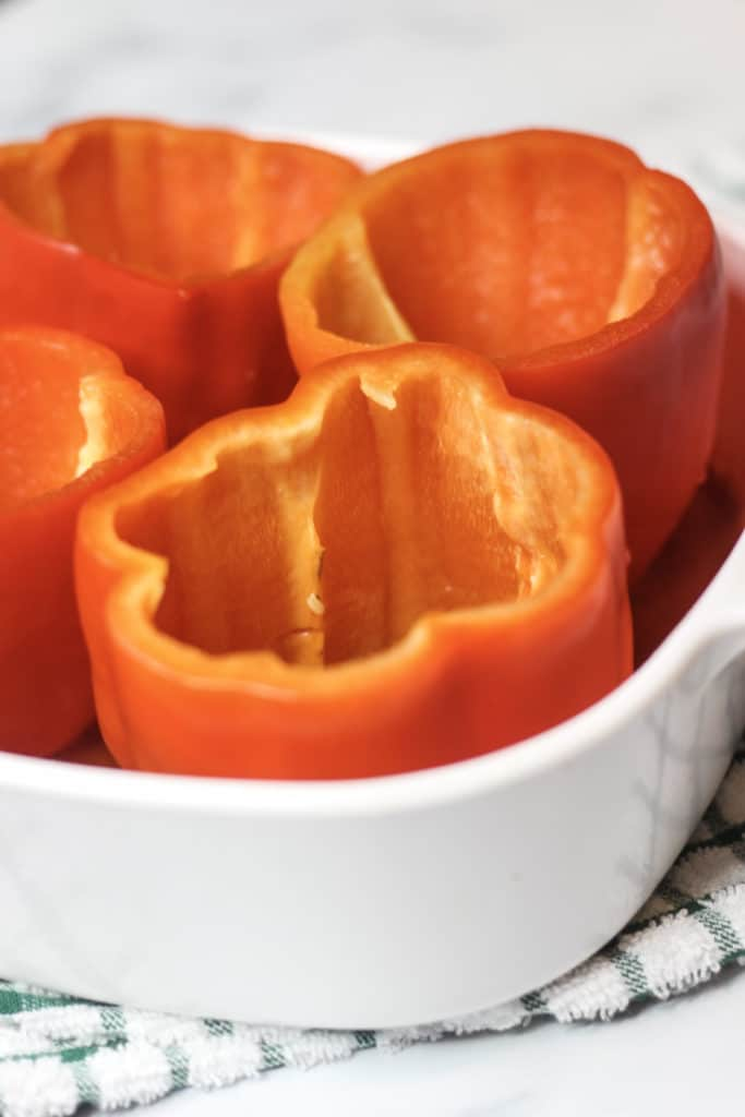 hollowed out red peppers for cheesy Italian stuffed pepper recipe