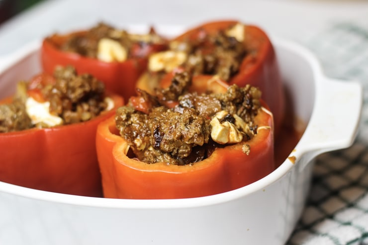 filled red peppers with tomato sauce, cheese and other ingredients