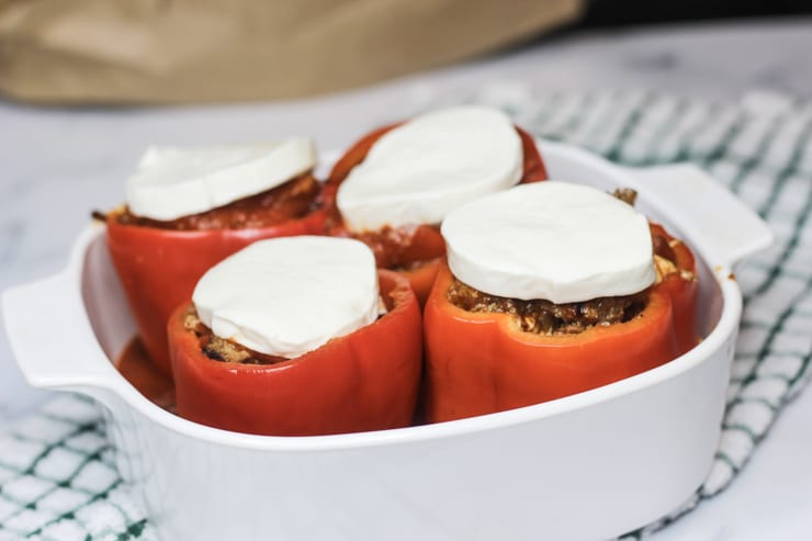 Cheesy Italian Stuffed Peppers in a white casserole dish on a counter