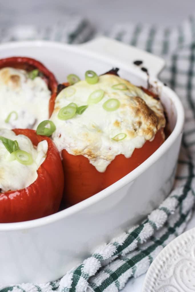 melted mozzarella on stuffed Italian peppers