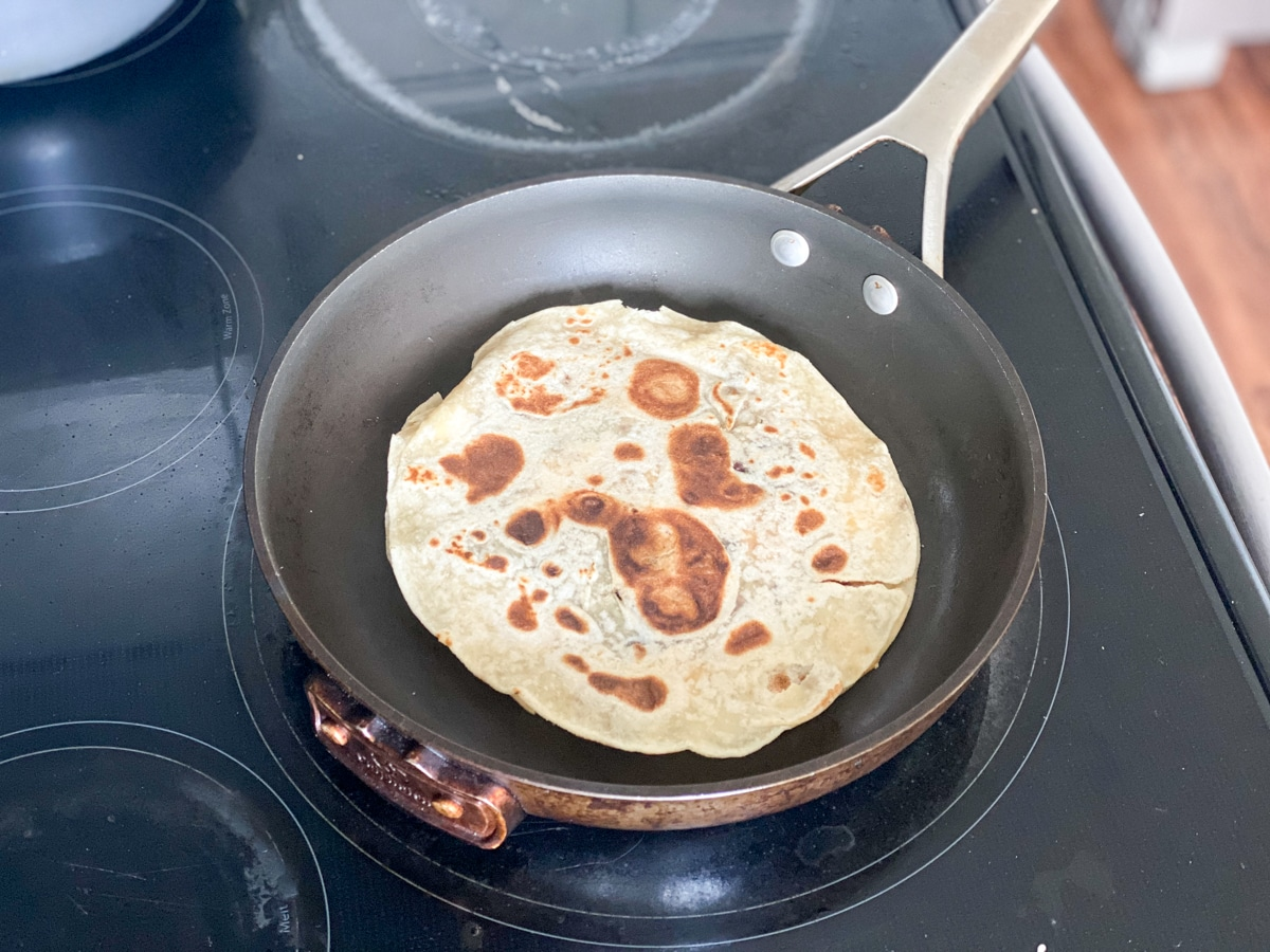 cooking a quesadilla on the stove