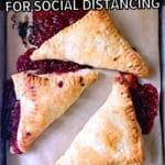3 raspberry turnovers on a baking sheet