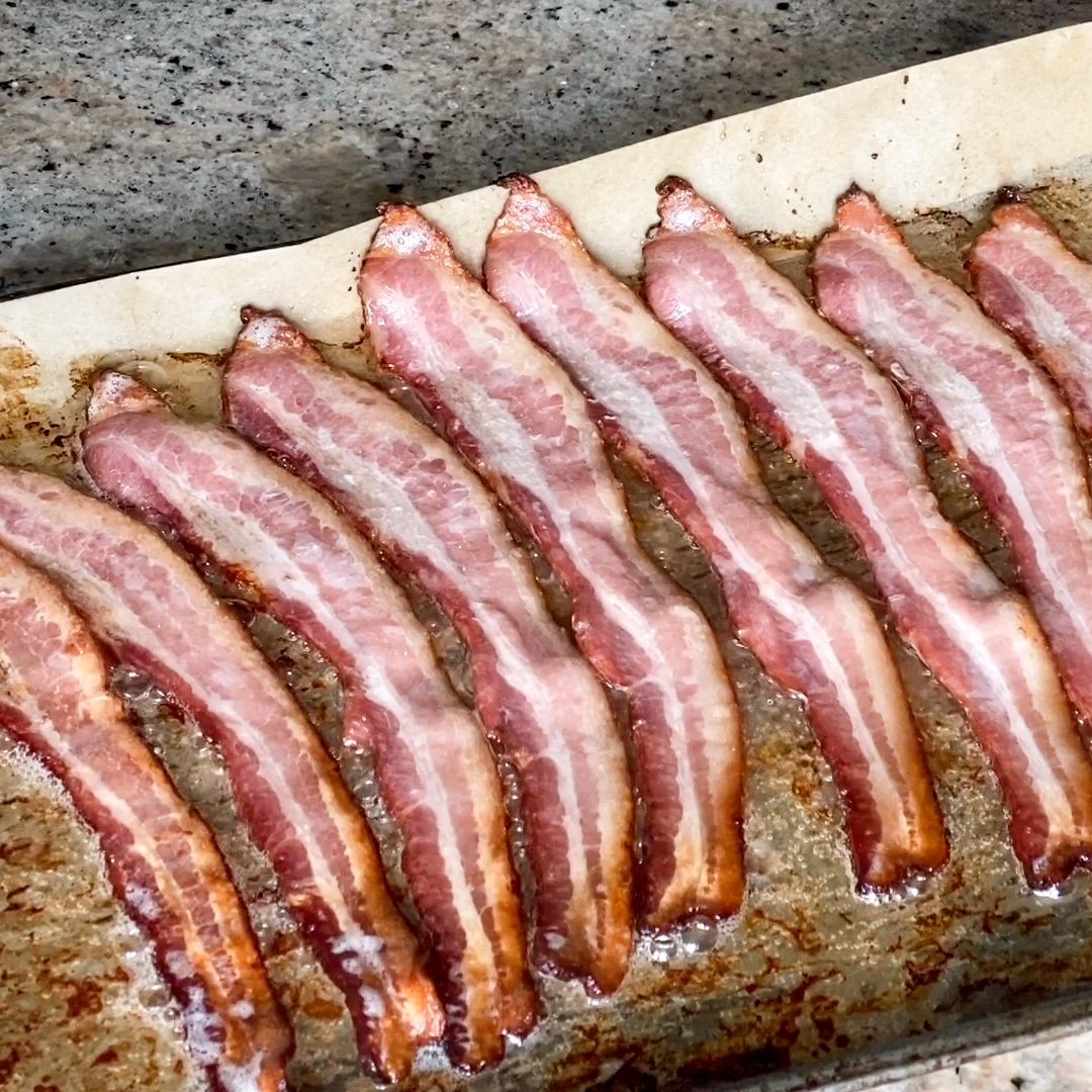 Oven cooked bacon on a sheet tray