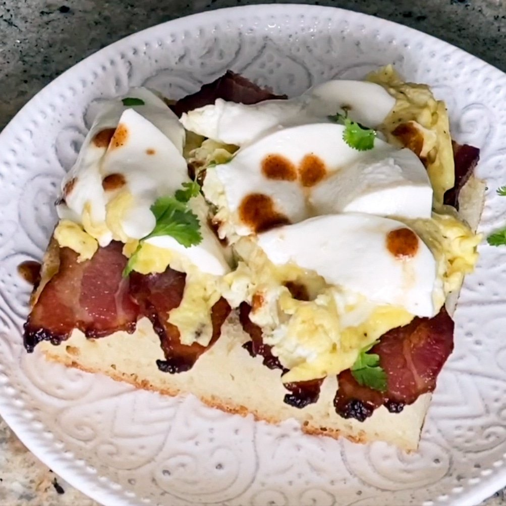 breakfast sandwich with mozzarella and hot sauce
