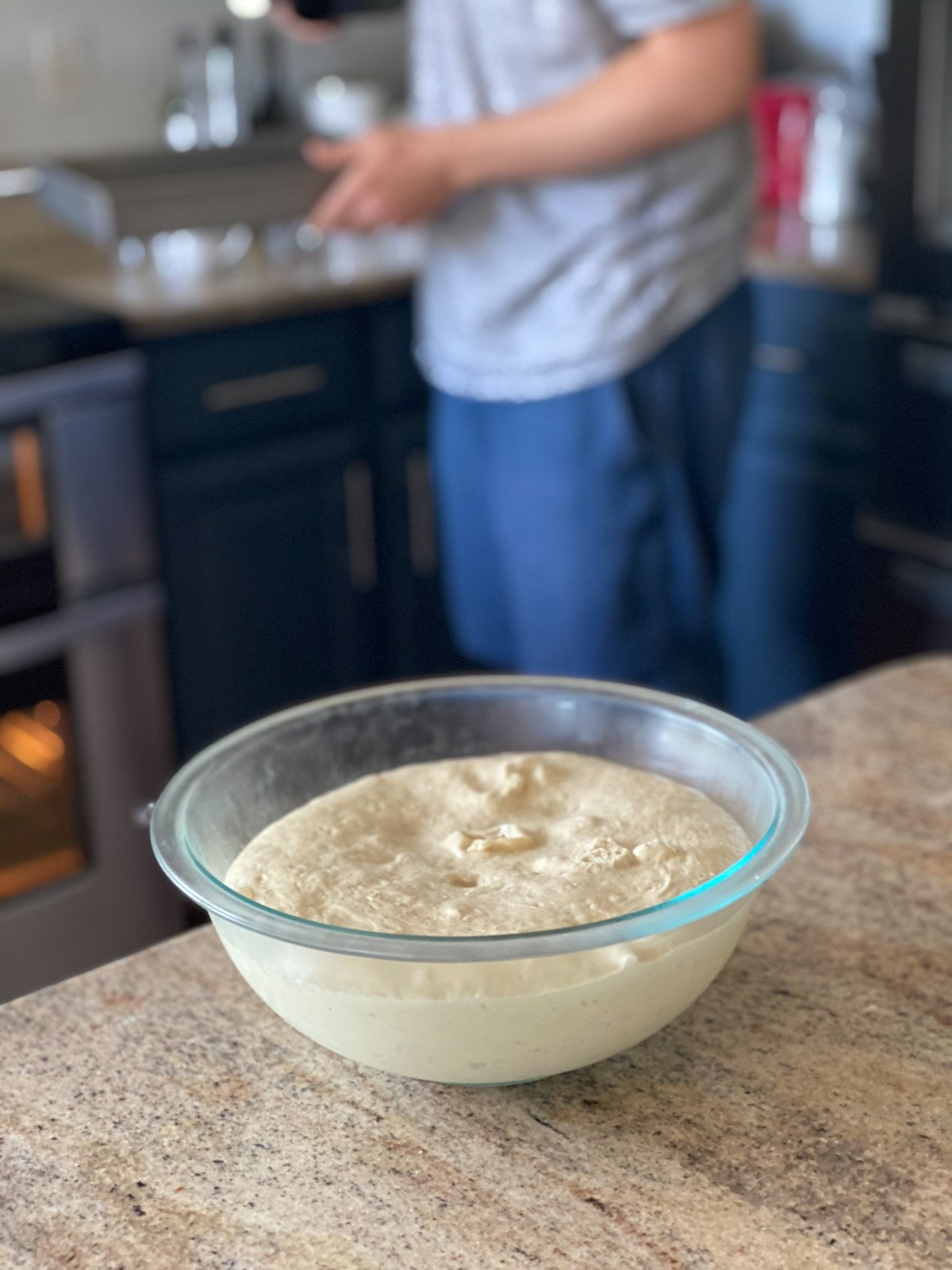 helping focaccia dough rise on the counter