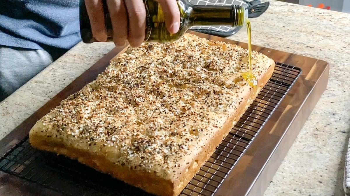 adding oil to focaccia bread