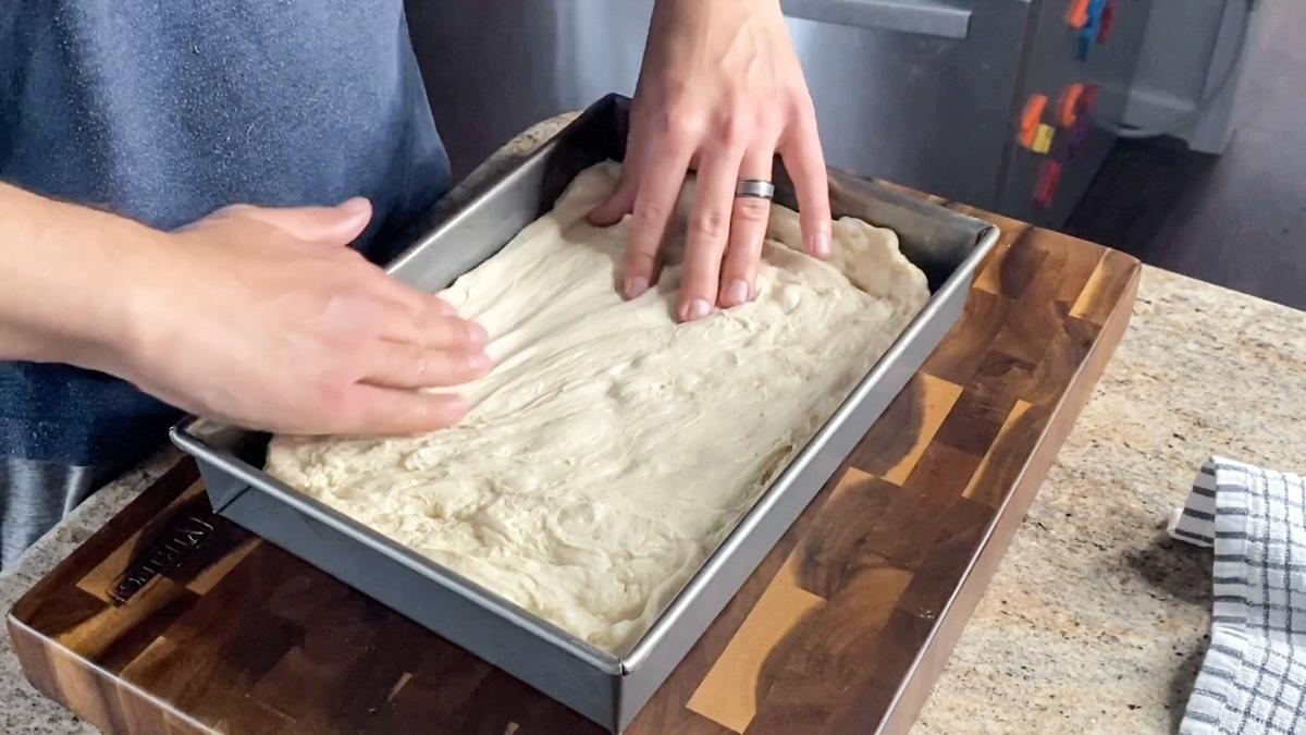stretching focaccia dough by hand