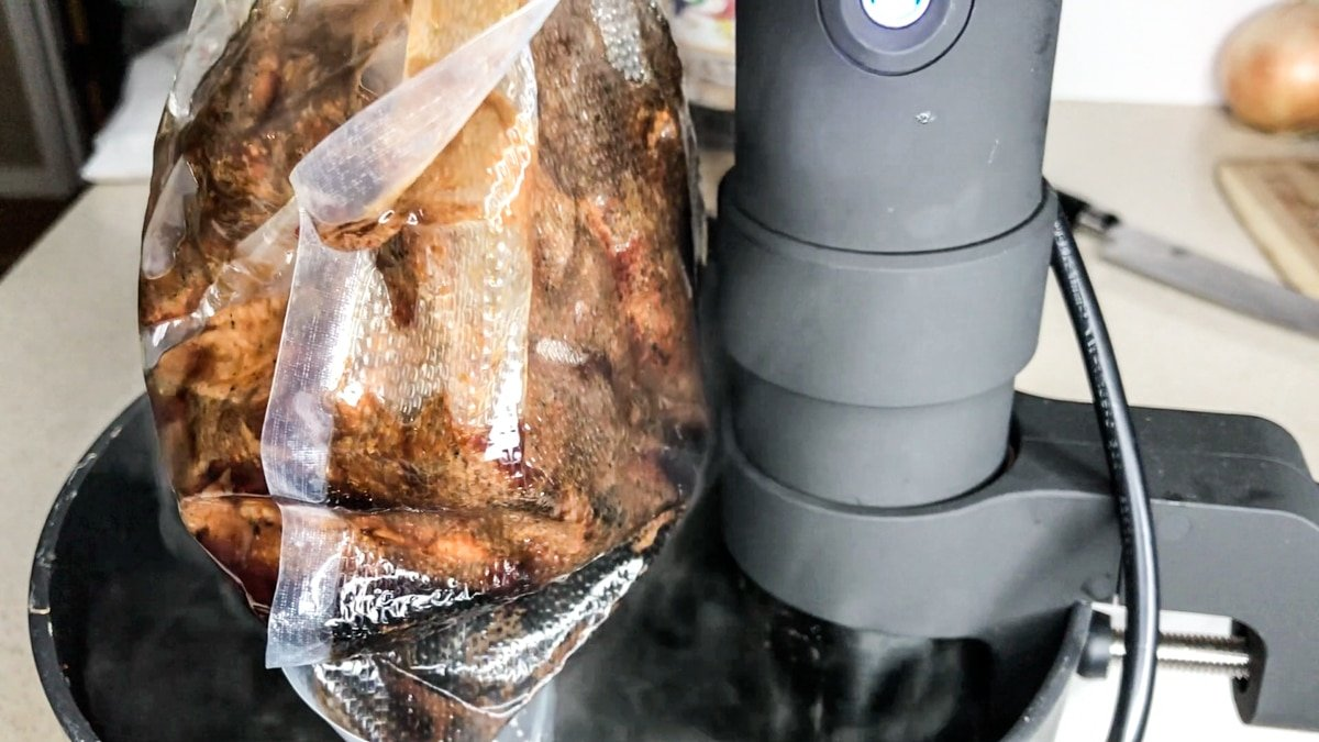 Sous vide cooking pork in vacuum sealed bags